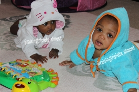 Twins play after their bath while big sis bathes